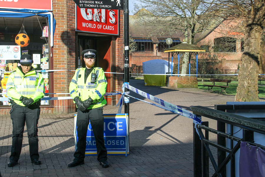 Salisbury, Wiltshire/UK - March 7 2018:  Police guard the bench Sergie and Yulia Skripal were found in The Maltings Shopping Centre during the Novichok incident.